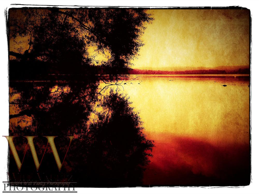 Orange morning sun on lake