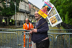 Pictured: Protester organiser Dave Lewellen tried in vain to call up reinforcements as the rain poured down.<br /> <br /> A protest outside the American consulate in Edinburgh turned out to be a bit of a let down with only one protester making his presence felt.  He was outnumbered by the police but about 80-1.  The barriers in place were left dripping wet as were the police without having to deal with protesters.<br /> <br /> Ger Harley | EEm 13 July 2018