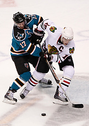 May 18, 2010; San Jose, CA, USA; San Jose Sharks center Torrey Mitchell (17) and Chicago Blackhawks center Jonathan Toews (19) fight for the puck during the first period of game two of the western conference finals of the 2010 Stanley Cup Playoffs at HP Pavilion.  The Blackhawks defeated the Sharks 4-2. Mandatory Credit: Jason O. Watson / US PRESSWIRE