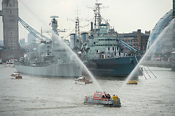 © Licensed to London News Pictures. 09/09/2015. London, UK. A flotilla passes in front of HMS Belfast and Tower Bridge as part of a a Royal River Salute on the Rivet Thames in London to mark the Queen becoming the longest reigning monarch in British history. The Queen will have reigned for 63 years and seven months , passing the record set by her great-great-grandmother Queen Victoria. Photo credit: Ben Cawthra/LNP