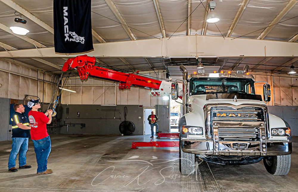 Matthew Adams works with the boom of a 2016 Mack Granite with a 50-ton Century rotator at Mike Adams Towing and Air Cushion Recovery, March 22, 2016, in Macon, Georgia. Adams started his business with a 1993 with a 1989 Mack Super-Liner. Today, he owns 27 towing and recovery trucks, nearly a third of which are Macks. (Photo by Carmen K. Sisson/Cloudybright)