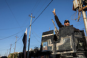 A Golden Division humvee turret gunner waves to residents of the newly liberated neighborhood of Aden in Eastern Mosul. Mosul, Iraq. Nov. 25, 2016. (Photo by Gabriel Romero ©2016)