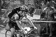 Picture by Andrew Tobin/Tobinators Ltd +44 7710 761829<br /> 04/08/2013<br /> A rider is splashed as he passes a pool during the Cycle Messenger World Championships held in Lausanne, Switzerland. Started in 1993 by Achim Beier from Berlin, the championships are not only a sporting contest but an opportunity to unite friends and bicycle enthusiasts worldwide. The event comprises a number of challenges including a sprint, a track stand (longest time stationary on the bike), a cargo race where heavy loads are carried on special bikes, and the main race. The course winds through central Lausanne and includes bridges, stairs, cobbles, narrow alleyways and challenging hills. The main race simulates the job of a bike courier making numerous drops and pickups across the city. Riders need to check in at specific checkpoints, hand over their delivery and get a new one. The main race can take up to 4 hours for each competitor to complete.