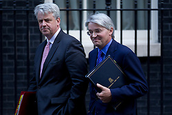 © Licensed to London News Pictures. 16/10/2012. LONDON, UK. Andrew Mitchell, the Chief Whip (R) is seen leaving number 10 Downing Street with Andrew Lansley, Leader of the Commons after today's meeting of David Cameron's cabinet in London today (16/10/12). Photo credit: Matt Cetti-Roberts/LNP