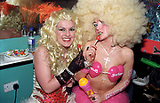 Two 'Garland' girls wearing blonde wigs and eating lollipops, Garlands, Liverpool, UK, 2002