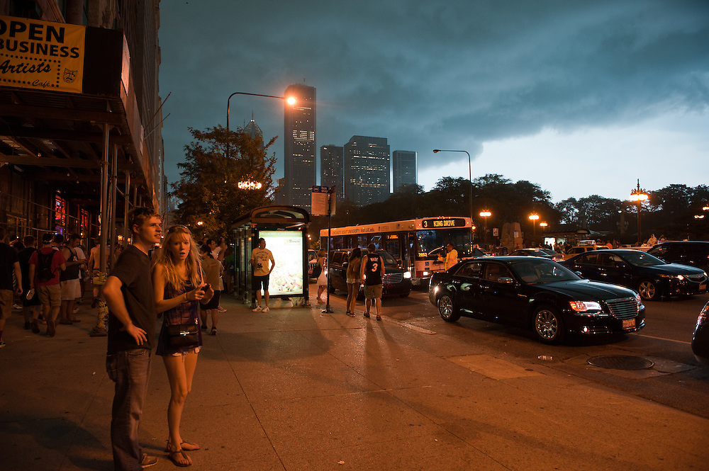 Lollapalooza attendees evacuate Grant Park as severe storms close in on August 4, 2012.