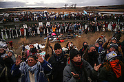 Protestors raise their arms during a prayer at an action defending what they claim to be a sacred site near Turtle Island against construction of the Dakota Access Pipeline in Cannon Ball, North Dakota in November 2016.<br /> <br /> Protestors have gathered on disputed Army Corps of Engineers land just north of the reservation to protest the construction of the pipeline underneath the Lake Oahe reservoir of the Missouri River for months since early 2016. Protestors say that the pipeline poses the possibility of contamination of the Standing Rock Sioux Tribe's primary water source.