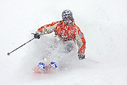 "SHOT 12/6/2007 - A skiier plows through some fresh powder at Crested Butte Mountain Resort one afternoon. Images of dining, shopping and places to stay in the town of Crested Butte, Co. A former coal mining town now called ""the last great Colorado ski town"", Crested Butte is a popular destination for skiing, mountain biking, and a variety of other outdoor activities. The town also features Elk Avenue, an historic main street where much of the shopping and dining is located. The primary winter activity in Crested Butte is skiing or snowboarding at nearby Crested Butte Mountain Resort in Mount Crested Butte, Colorado.(Photo by Marc Piscotty/ © 2007)"