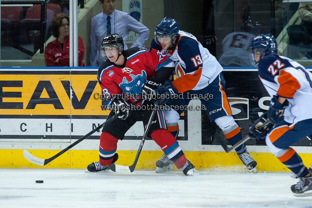 KELOWNA, CANADA - AUGUST 30: Joe Gatenby #25 of the Kelowna Rockets is checked by Eric Krienke #13 of the Kamloops Blazers on August 30, 2014 during pre-season at Prospera Place in Kelowna, British Columbia, Canada.   (Photo by Marissa Baecker/Shoot the Breeze)  *** Local Caption *** Joe Gatenby; Eric Krienke;