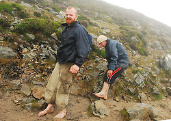 'Barefooted brothers' Joe and Brendan O'Brien from Knocklong Co Limerick.picking their steps carefully down Croagh Patrick on sunday...Pic Conor McKeown