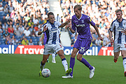 West Bromwich Albion defender Kieran Gibbs (3) tackles Stoke City striker Peter Crouch (25) during the EFL Sky Bet Championship match between West Bromwich Albion and Stoke City at The Hawthorns, West Bromwich, England on 1 September 2018.