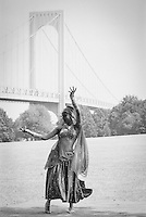 Bronx, New York: A Guyanese dancer performs during a crcket match beneath the Whitestone Bridge