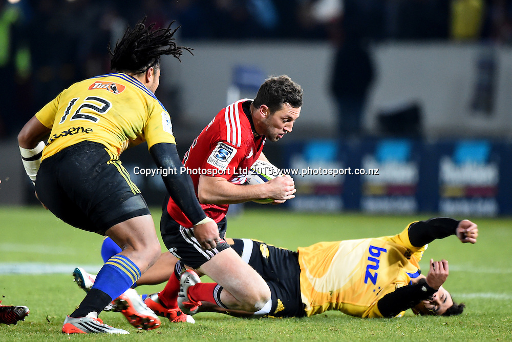 Crusaders player Tom Taylor busts through the tackle of Hurricanes Matt Proctor during their Investec Super Rugby game Crusaders v Hurricanes. Trafalgar Park, Nelson, New Zealand. Friday 29 May 2015. Copyright Photo: Chris Symes / www.photosport.co.nz