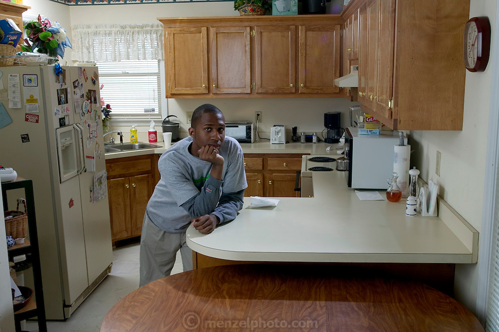(MODEL RELEASED IMAGE). Brandon Demery in his home in Raleigh, North Carolina. (Supporting image from the project Hungry Planet: What the World Eats.)