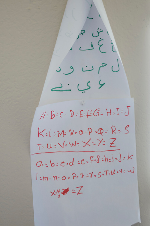 The Pashto and English alphabet hang on the wall of Gulab's home in Fort Worth, Texas on May 6, 2016.