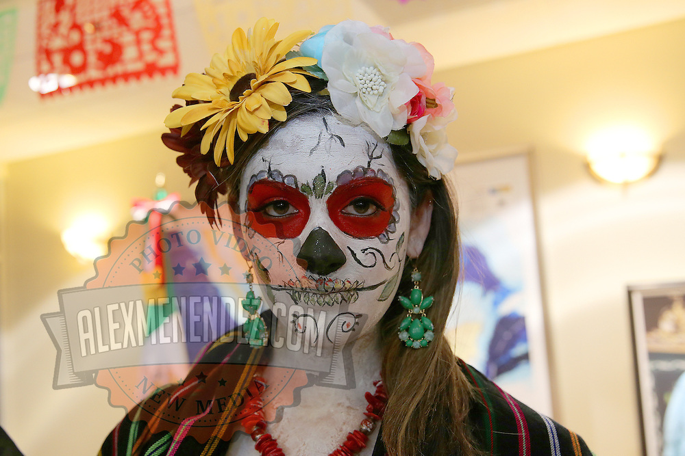 "The celebration of Day of the Dead or ""Día de los Muertos"" at the Mexican Consulate in Orlando, Florida on Saturday, November 2, 2013. Dia de los Muertos is a Latin holiday celebrating friends and family members who have died. Traditions include building private altars called ofrendas to honor the deceased using sugar skulls, marigolds, and the favorite foods and beverages of the departed and visiting graves with these as gifts. (AP Photo/Alex Menendez)"