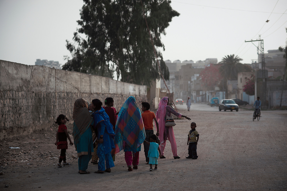 Women ad children walk near Sadhu Bela, a Hindu temple on the Indus River, Sukkur, Sindh province, Pakistan on March 23, 2012. A rise in in reports of forced conversion of Hindu girls to Islam in provinces in Pakistan has gained prominence within the political, media, religious and social domains with the case of a 21 year old woman Rinkle Kumari. On February 24, 2012 her family reported to police of Ghotki district, Sindh province that she had been abducted by armed men from the family home in the village of Mirpur Mathelo. it is then alleged by the family and broadrer hindu community that she was forced to convert to Islam and marry Syed Naveed Shah, a neighbour of the girl within their village. Complications with court hearings for the case, perceptions by the Muslim community that the police sided with the Muslim community when dealing with issue and the politicisation of the case by a Pakistan Peoples Party Member for National Assembly Mian Abdul Haq alias Mian Mitho has led to a hearing being called in the Supreme Court, Islamabad, Pakistan on March 26, 2012. The hearing will hopefully ascertain whether the girl was abducted or in fact left with Syed Naveed Shah of her own free will.