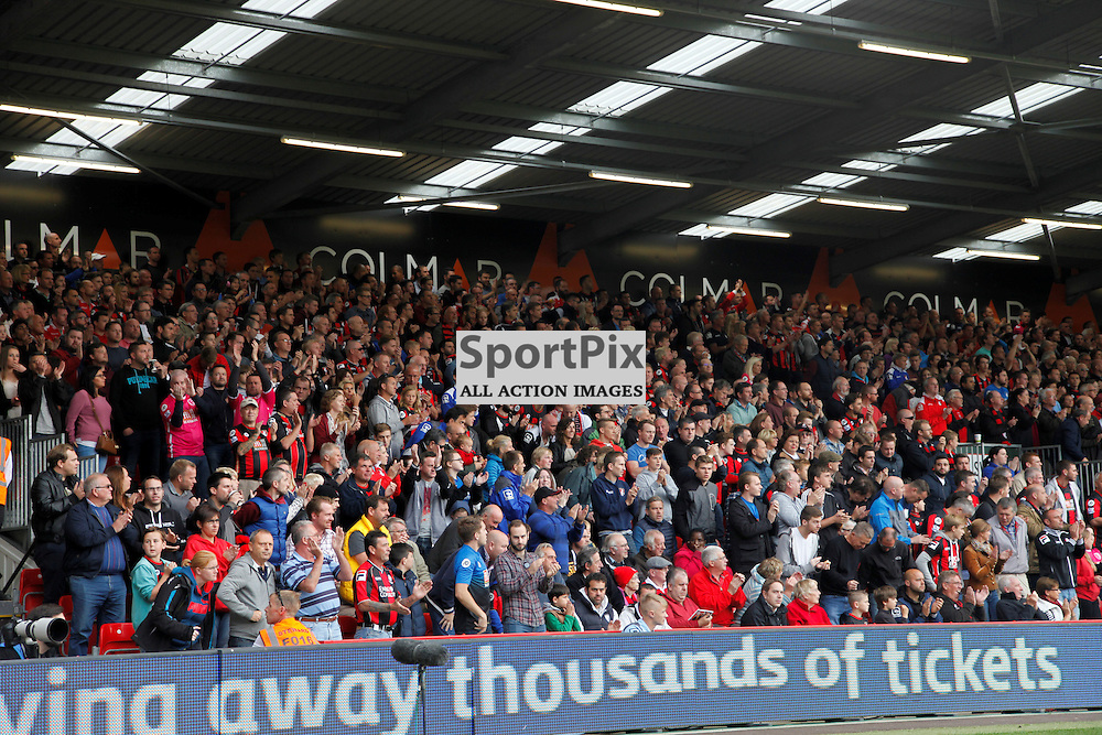 Dean Court applauds the life of Mick Cunningham a local photographer who worked for Bournemouth for 20 years During Bournemouth vs Watford on Saturday 3rd of October 2015.