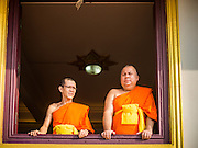 30 OCTOBER 2014 - BANGKOK, THAILAND: Buddhist monks in the chedi at Wat Saket during the parade marking the start of the annual temple fair at Wat Saket. Wat Saket is on a man-made hill in the historic section of Bangkok. The temple has golden spire that is 260 feet high which was the highest point in Bangkok for more than 100 years. The temple construction began in the 1800s in the reign of King Rama III and was completed in the reign of King Rama IV. The annual temple fair is held on the 12th lunar month, for nine days around the November full moon. During the fair a red cloth (reminiscent of a monk's robe) is placed around the Golden Mount while the temple grounds hosts Thai traditional theatre, food stalls and traditional shows.   PHOTO BY JACK KURTZ