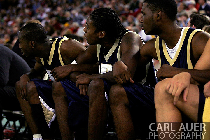 25 November 2005: Oral Roberts University players lock arms on the bench during the 70-73 loss to Marquette University at the Great Alaska Shootout in Anchorage, Alaska