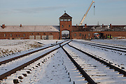 "The main entrance - also called ""the gate of death"" - at the Auschwitz Birkenau site. It is estimated that between 1.1 and 1.5 million Jews, Poles, Roma and others were killed in Auschwitz during the Holocaust in between 1940-1945."