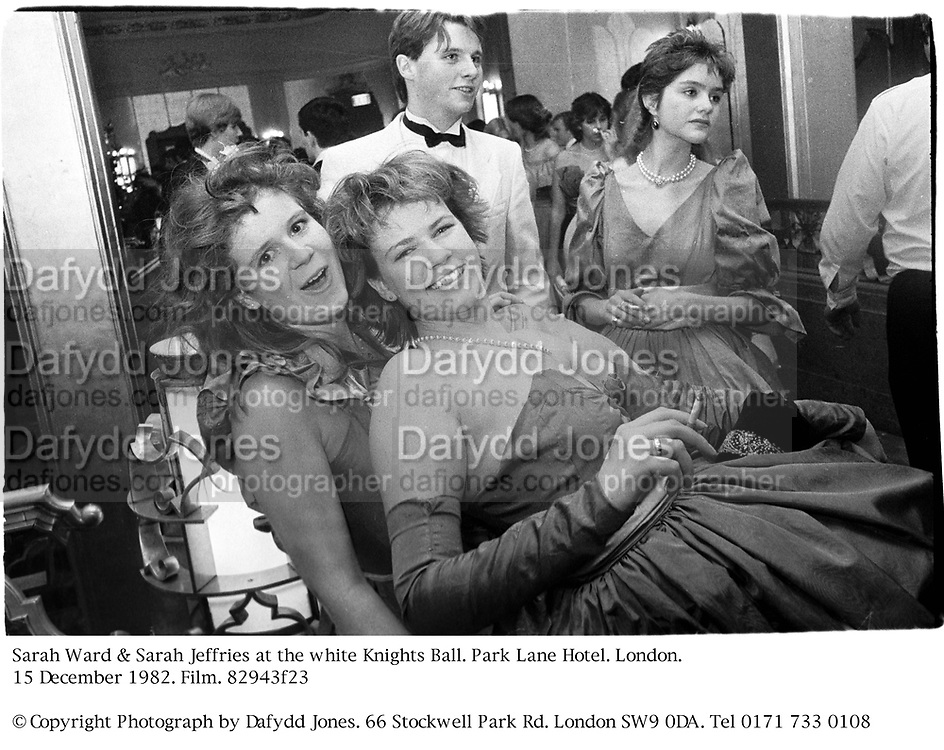 Sarah Ward & Sarah Jeffries At the white Knights Ball. Park Lane Hotel. London. 15 December 1982. Film. 82943f23<br />