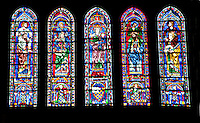 Our Lady of Chartres Cathedral, Chartres, France. South Transept Windows. The central lancet beneath the rose shows the Virgin carrying the infant Christ. Either side of this are four lancets showing the four evangelists sitting on the shoulders of four Prophets. This window was a donation of the Mauclerc family, the Counts of Dreux-Bretagne, who are depicted with their arms in the bases of the lancets.
