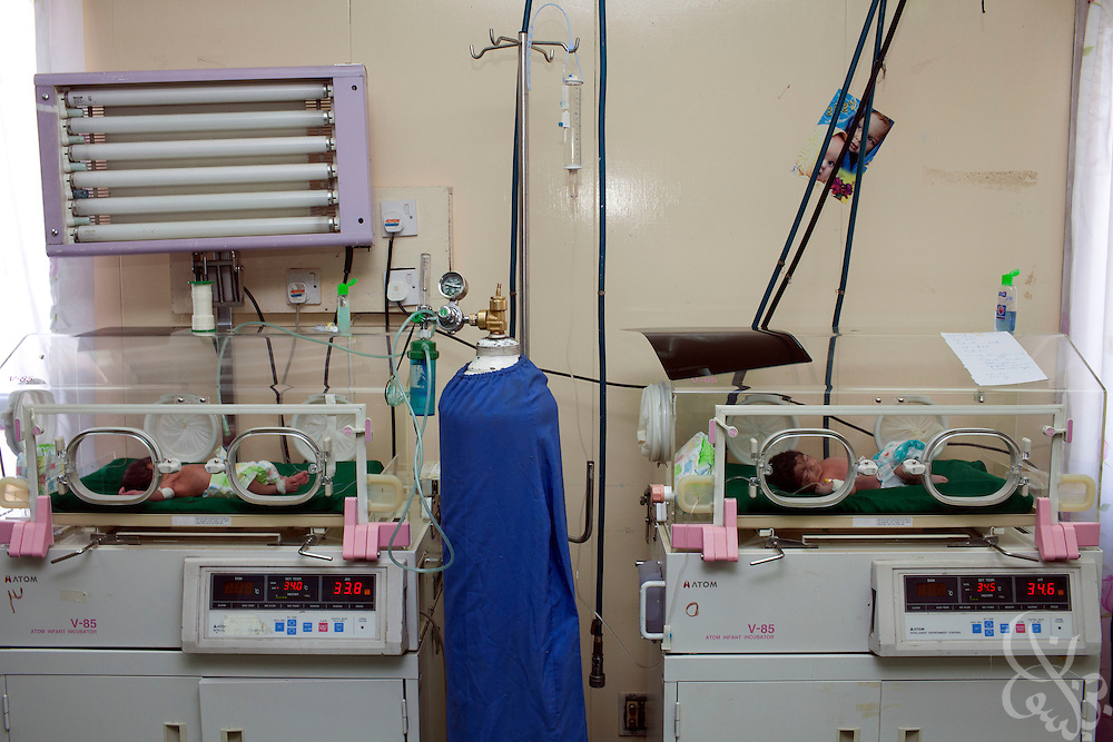 Premature Iraqi babies sleep in incubators at the neonatal wing of the Khadamiyah hospital in Baghdad August 25, 2010. After seven years of conflict,  Iraqi hospitals continue to be overcrowded, in a state of disrepair and stocked with old or outdated medical equipment.   .