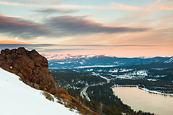 """Donner Lake Sunset 29"" - Photograph of a full moon rising and a snowy and rocky scene above Donner Lake and Truckee, California at sunset."
