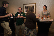 Mentors and mentees, Devon Baum and Dr. Robert Williams, along with Dr. Joann Benigno and Kelsey Davis conversate before dinner. © Ohio University / Photo by Olivia Wallace