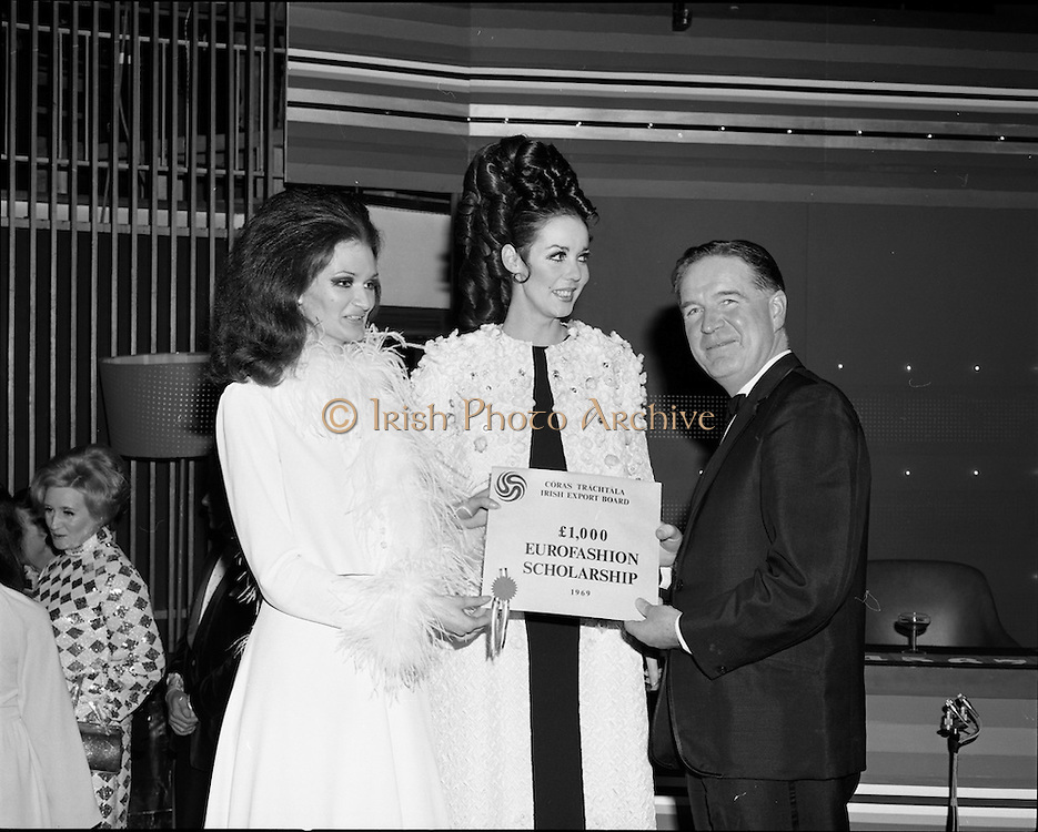 07/01/1969.01/07/1969.07 January 1969.Eurofashion Final at Shelbourne Hotel. The Irish section of the 1969 Eurofashion Contest judged by John McGuire, Miss Leonora Currie and Mrs Nuala Mc Laughlin. Pictured are winner Colette Dowling (21) Kincora Road, Clontarf, and model Liz Willoughby, wearing one of the winning outfits, recieving  the prize of a £1,000 overseas design scholarship presented by Coras Trachtala.