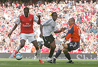 Photo: Steve Bond.<br />Arsenal v Derby County. The FA Barclays Premiership. 22/09/2007. Emmanual Adebayor (L) goes past Claude Davis (C) and keeper Stepehen Bywater to score no2