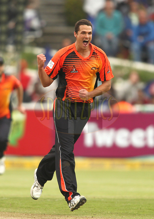 Nathan Coulter-Nile of Perth Scorchers celebrates Naman Ojha of the Delhi Daredevils wicket during match 15 of the Karbonn Smart CLT20 South Africa between The Perth Scorchers and the Delhi Daredevils held at Newlands Stadium in Cape Town, South Africa on the 21st October 2012..Photo by Shaun Roy/SPORTZPICS/CLT20