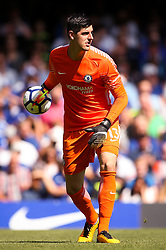 """Chelsea's Thibaut Courtois during the Premier League match at Stamford Bridge, London. PRESS ASSOCIATION Photo. Picture date: Sunday August 27, 2017. See PA story SOCCER Chelsea. Photo credit should read: Scott Heavey/PA Wire. RESTRICTIONS: EDITORIAL USE ONLY No use with unauthorised audio, video, data, fixture lists, club/league logos or """"live"""" services. Online in-match use limited to 75 images, no video emulation. No use in betting, games or single club/league/player publications."""