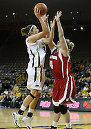 19 February 2009: Iowa forward Wendy Ausdemore (32) puts up a shot over Wisconsin center Tara Steinbauer (4) during the first half of an NCAA women's college basketball game Thursday, February 19, 2009, at Carver-Hawkeye Arena in Iowa City, Iowa. Iowa defeated Wisconsin 72-65.