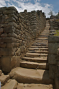 Stairs of the ruins of the lost city of Machu Picchu. Located in the region of Cusco in Peru.