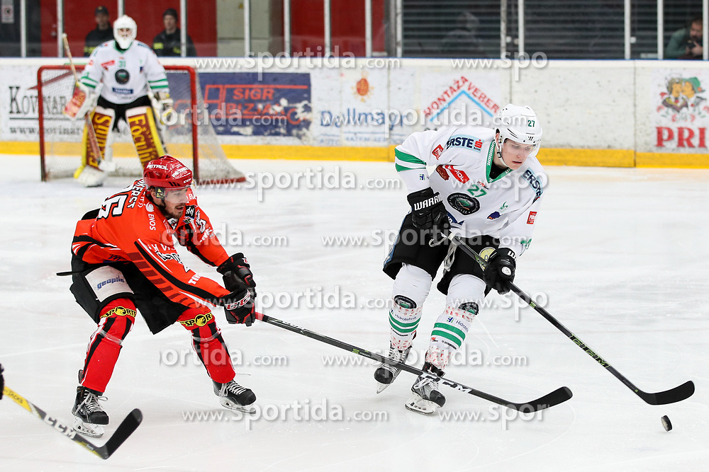Mark Cepon of Olimpija and Jaka Ankerst of Jesenice during ice hockey match between HDD SIJ Acroni Jesenice and HDD Olimpija Ljubljana in Final of Slovenian League 2016/17, on April 9, 2017 in Podmezaklja, Jesenice, Slovenia. Photo by Matic Klansek Velej / Sportida