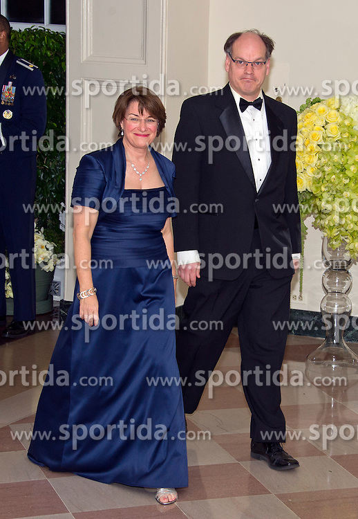 United States Senator Amy Klobuchar (Democrat of Minnesota) and John Bessler arrive for the State Dinner in honor of Prime Minister Trudeau and Mrs. Sophie Gr&eacute;goire Trudeau of Canada at the White House in Washington, DC on Thursday, March 10, 2016. EXPA Pictures &copy; 2016, PhotoCredit: EXPA/ Photoshot/ Ron Sachs<br /> <br /> *****ATTENTION - for AUT, SLO, CRO, SRB, BIH, MAZ, SUI only*****