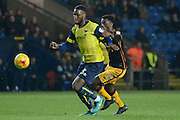 Oxford United defender Cheyenne Dunkley (33) holds off Bradford City striker Jordy Hiwula (11) 0-0 during the EFL Trophy match between Oxford United and Bradford City at the Kassam Stadium, Oxford, England on 31 January 2017. Photo by Alan Franklin.