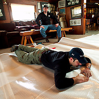 (PSTORE) Red Bank 1/28/2004  Brian Rice and Buzz Chase places ribs ( checking correct name) into a new sail inside of the ice boat club.   Michael J. Treola Staff Photographer.......MJT