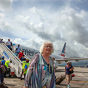 Valerie More disembarks from an American Airlines flight from Miami at Jose Marti airport in Havana.<br /> Photography by Jose More