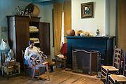 Craftsperson spinning cotton, Vermilionville museum of Acadian Cajun, Creole, Native American culture, Lafayette, Louisiana, USA