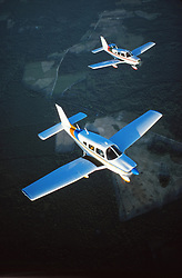 Two Single Engine Prop Planes Flying