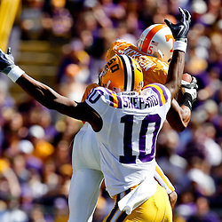 Oct 2, 2010; Baton Rouge, LA, USA; Tennessee Volunteers cornerback Janzen Jackson (15) intercepts a pass in front of LSU Tigers wide receiver Russell Shepard (10) during the first half at Tiger Stadium.  Mandatory Credit: Derick E. Hingle