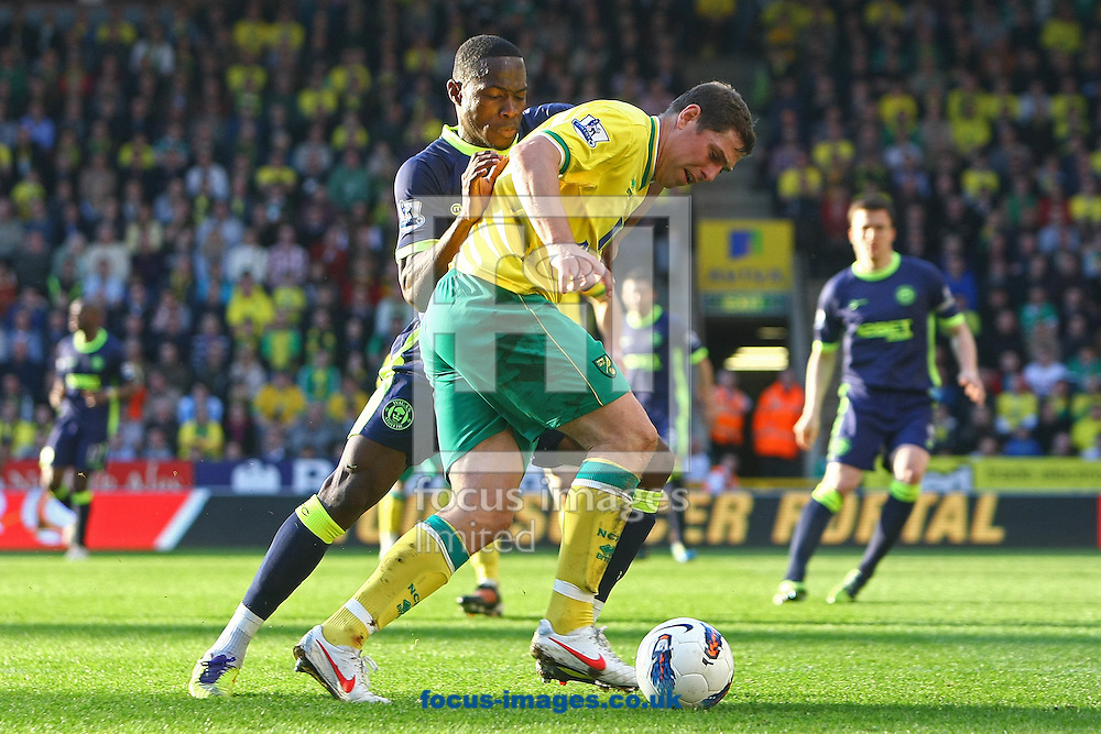 Picture by Paul Chesterton/Focus Images Ltd.  07904 640267.11/03/12.Grant Holt of Norwich and Maynor Figueroa of Wigan in action during the Barclays Premier League match at Carrow Road Stadium, Norwich.