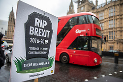 © Licensed to London News Pictures. 02/04/2019. London, UK. An anti-Brexit placard opposite Parliament as rain falls over London. Prime Minister Theresa May is chairing a Cabinet meeting to try and agree a path forward with ministers after MPs voted to reject all alternatives to the Withdrawal Agreement for a second time. Photo credit: Rob Pinney/LNP
