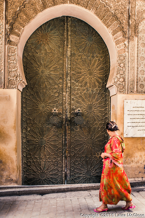 Huge Metal Doorway with woman walking by, Morocco