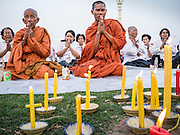 """31 JANUARY 2013 - PHNOM PENH, CAMBODIA:  Buddhist monks lead a prayer service for former King Norodom Sihanouk in front of the Royal Palace in Phnom Penh. Norodom Sihanouk (31 October 1922- 15 October 2012) was the King of Cambodia from 1941 to 1955 and again from 1993 to 2004. He was the effective ruler of Cambodia from 1953 to 1970. After his second abdication in 2004, he was given the honorific of """"The King-Father of Cambodia."""" Sihanouk served two terms as king, two as sovereign prince, one as president, two as prime minister, as well as numerous positions as leader of various governments-in-exile. He served as puppet head of state for the Khmer Rouge government in 1975-1976. Most of these positions were only honorific, including the last position as constitutional king of Cambodia. Sihanouk's actual period of effective rule over Cambodia was from 9 November 1953, when Cambodia gained its independence from France, until 18 March 1970, when General Lon Nol and the National Assembly deposed him. Upon his final abdication, the Cambodian throne council appointed Norodom Sihamoni, one of Sihanouk's sons, as the new king. Sihanouk died in Beijing, China, where he was receiving medical care, on Oct. 15, 2012. His funeral procession, which will wind through Phnom Penh is Friday, Feb.1 and his cremation is on Feb. 4, 2013. Over a million people are expected to attend the service.    PHOTO BY JACK KURTZ"""