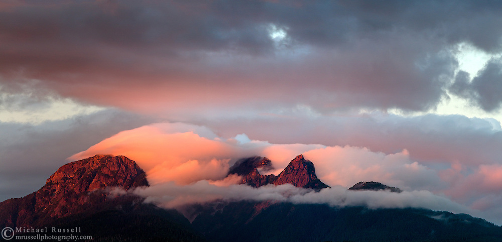 Glowing sunset louds clear off the Golden Ears (Mount Blandshard) at sunset in the Coast Mountains of British Columbia, Canada