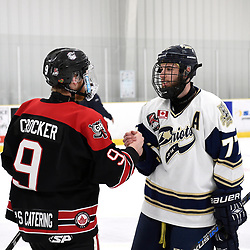 TORONTO, ON  - APR 10,  2018: Ontario Junior Hockey League, South West Conference Championship Series. Game seven of the best of seven series between Georgetown Raiders and the Toronto Patriots. Jordan Crocker #9 of the Georgetown Raiders and Nick Kalpousos #77 of the Toronto Patriots after the final buzzer of the South West Conference.<br /> (Photo by Andy Corneau / OJHL Images)
